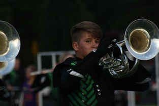 "Junior James Derloshon performs with the FC marching band. ""My favorite part about band is being able to perform with the friends that I have made the past three years,"" said Derloshon. Photo by Sophia Perigo."