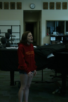 Junior Isabella Arnett sings her audition song at practice before auditions on Aug. 2. Photo by Sophia Perigo.