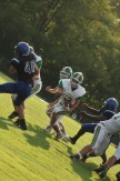 """Senior Bison Pirtle maneuvers around a Charlestown player in hopes of getting the ball further down the field. """"I've been playing football since the day I could sign up,"""" said Pirtle. Photo by Sophia Perigo."""