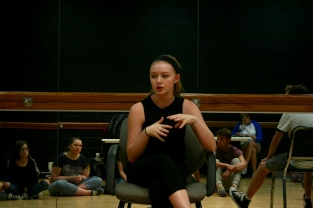 Senior Sara Seay discusses how dance auditions will work to her fellow Thespians. Photo by Sophia Perigo.