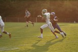 """Sophomore Wenkers Wright runs towards the end zone. """"My favorite thing about football would have to be the bond you make with your teammates on the field,"""" said Wenkers. Photo by Sophia Perigo."""