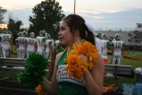 """Junior Jordan Mazza looks to her side and talks to her teammate about what cheer they are about to do. """"My favorite part about games is just being in front of the crowd cheering on my school,"""" said Mazza. Photo by Sophia Perigo."""