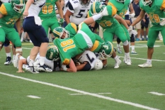 Junior Seth Cook tackles a lineman to stop Providence from advancing yards. Photo by Taylor Watt.