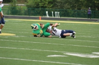 Senior Jon Gunn keeps his grasp on the ball as he is tackled to the ground. Photo by Taylor Watt.