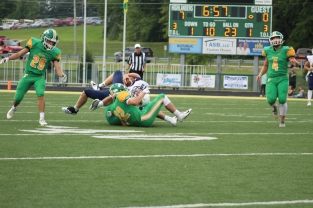 Senior Lucas Moosier tackles an opposing quarterback to defend the 7-0 score in the first quarter. Photo by Taylor Watt.