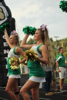 Seniors Emma King and Olivia Fontan start a cheer to anticipate the next touchdown, as the close score against Providence keeps nerves running high in the second quarter. Photo by Taylor Watt.