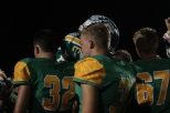 The FC Highlanders gather around in a huddle as they raise their helmets just above their heads and faintly lead each other in the team chant. The final score was 45-0, Columbus East won. Photo by Brooke Miller.
