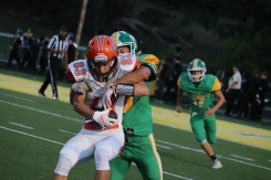 Senior Miles Frazier tackles a Columbus East player that is running with the ball before he can get any closer to the end zone. Photo by Brooke Miller.
