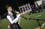 "Junior Connor Bickel plays a solo on his soprano saxophone in the middle of the FC marching band's performance during the second part of halftime show. ""It's so much fun to be the only one on the field who's playing. It's like I have full control and can change what happens. It's quite frankly amazing,"" said Bickel. Photo by Brooke Miller."