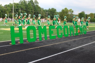 The Homecoming sign welcomes the crowd and the court before the football game against Columbus East begins. Photo by Grace Allen.