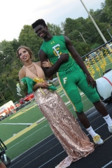"""Sophomores Shelby Hardin and Wenkers Wright lead the line of representatives as they look into the crowd for parents and friends. """"It felt special that I was chosen to represent the sophomore class for Homecoming,"""" said Hardin. Photo by Grace Allen."""