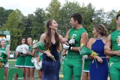 "Seniors Riley Woodruff and Jake Quenichet look at each other with surprised faces as Riley is announced 2018 Homecoming Queen. ""I was super shocked, but after that I was very excited,"" said Woodruff. Photo by Grace Allen."