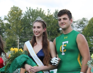 """Seniors Riley Woodruff and Jake Quenichet smile for photos by their friends and family as Woodruff proudly sports the queen's crown. """"This has been a really great experience, and I want to thank my friends, family, and my escort, Jake Quenichet, for making this a memorable night!"""" said Woodruff. Photo by Grace Allen."""