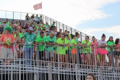 FC's Kilt Krew sports neon shirts to support the boys' football team and watch the Homecoming Queen be crowned. Photo by Grace Allen.