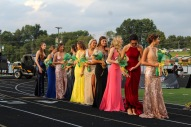 The Homecoming court lines up as they talk and get ready to walk out when their names are called. Photo by Grace Allen.