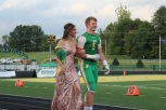 "Senior Emma Stewart is escorted by junior Seth Cook while in the running for Homecoming Queen. ""I was glad I could escort her and it gave me another thing to look forward to on a Friday night,"" said Cook. Photo by Grace Allen."