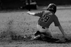 """Sixth grader, Riley Doddridge slides into second base after hitting a double at Little League Baseball Complex in Clarksville, IN against Vipers White. """"Even though we lost, I was happy that I was able to get a good hit and my friend, Preston Burton, hit a homerun,"""" said Doddridge. Photo by Ella Doddridge."""