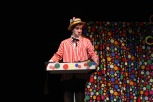 """Senior Noah Hankins walks away from Charlie after giving him a candy bar that may or may not contain a golden ticket. """"The hardest part of my role as Willy Wonka is having to be over the top in everything I do,"""" said Hankins. Photo by Sophia Perigo."""