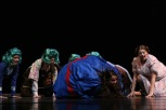"""Sophomore Caroline Siegrist, who plays Violet, rolls around on the stage floor after turning the size of a giant blueberry. """"This show really stands out from other shows I've been in because everyone has contributed to the show in their own way and left their mark,"""" said Siegrist. Photo by Sophia Perigo."""
