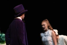 """Seniors Sarah Seay (Veruca Salt) yells at senior Noah Hankins (Willy Wonka) for not letting her have a squirrel. """"I try to feel what my character would feel when I perform because she wouldn't be nervous so I try not to be as well,"""" said Seay. Photo by Sophia Perigo."""