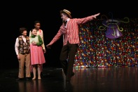 """Senior Noah Hankins, who plays Willy Wonka, sings """"Candy Man."""" """"Wonka is very over the top, and is very whimsical, unlike any role I have ever played before,"""" said Hankins. Photo by Sophia Perigo."""