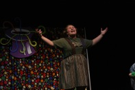 """Junior Emily North sings """"I Eat More"""" during a dress rehearsal the day before opening night. """"If I had to describe this show in three words it would be magical, candy, and extravaganza,"""" said North. Photo by Sophia Perigo."""
