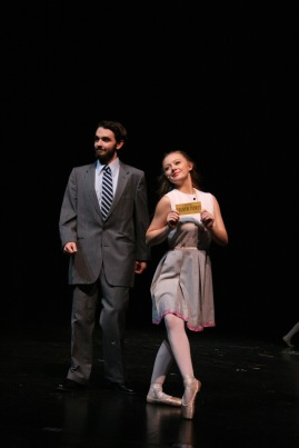 """Seniors Connor Nevitt and Sarah Seay look towards the """"camera"""" while getting interviewed after finding a golden ticket. """"I made my character a ballerina so I can dance all the way through the show and I love nothing more,"""" said Seay. Photo by Sophia Perigo."""
