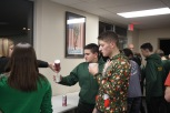 NJROTC cadets dig into the treats and hot chocolate brought in for their Christmas get together at Galena after their visit with the senior citizens at Riverview Towers and Mark Elrod Towers. Photo by Aurora Robinson.