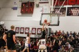 """Senior Logan Libs dunks the ball on the rival team, scoring the fourth basket for the Highlanders. """"At the end of the day, it's what you did as a player to contribute to the team win, which feels great,"""" said Libs. Photo by Grace Allen."""