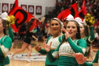 Seniors Makenna Moravec and Taylor Sattler support their team by leading the cheers for the student section. Photo by Grace Allen.