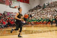 Senior Nick Winchell dribbles down the court towards the goal in hopes of scoring. Photo by Grace Allen.