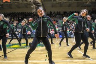 Freshman Jillian Hadley stands in front as the dazzler team dances in the pep rally on Friday, January 18th. Photo by Grace Allen.