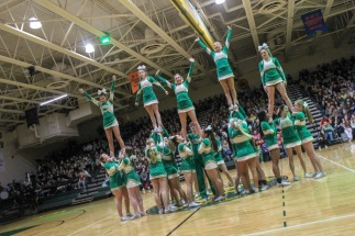 The Floyd Central cheer team finishes their routine and waves to the crowd as they dismantle their stunts. Photo by Grace Allen.