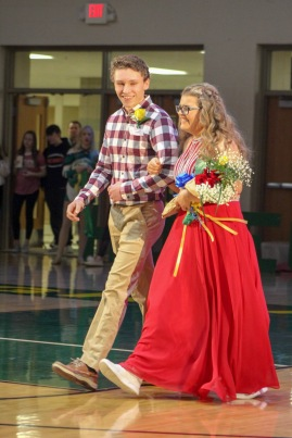 Senior Kelby Rippy walks out senior Laiken Lancaster as part of the Homecoming court. Photo by Grace Allen.