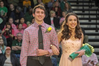 Seniors Kaden Breger and Maren Meunier smile at the crowd and cameras during homecoming. Photo by Grace Allen.