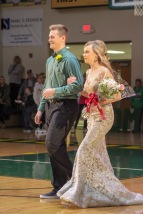 Senior Bryce Schindler links arms with senior Morgan Spanopoulos as they walk out together for Homecoming. Photo by Grace Allen.
