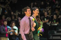 Seniors Kaden Breger and Cassie Thomerson link arms and walk forward as they are called for 2019 Homecoming king and queen. Photo by Grace Allen.
