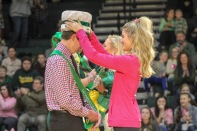 Senior Sydney Palmer places a crown on senior Kaden Breger's head to show he is Homecoming King. Photo by Grace Allen.