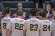 Juniors Harrison Sprigler, Luke Gilland, John Fonda, and Ben Purvis huddle with their team before the volleyball game against Scottsburg begins. Photo by Grace Allen.