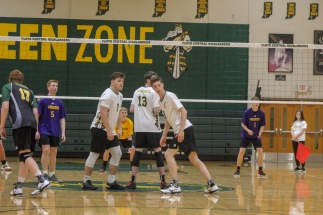 Senior Jake Quenichet and junior Harrison Sprigler get in ready position to run to their places after their teammate serves the ball. Photo by Grace Allen.