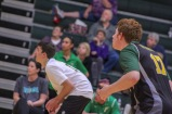 """Senior Kaden Breger and junior Cole Gibson eye the ball and the opposing team as they get ready to move wherever needed to get the point. """"I think that men's volleyball should be an official FC sport because we would be able to get better equipment, travel to play teams farther away, and it would help with getting new players to join the program,"""" said Gibson. Photo by Grace Allen."""