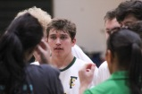 As the game comes to a close, junior Ben Purvis listens intently to the coaches about the team's progress and how they played. Photo by Grace Allen.