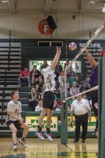 Sophomore Logan Gamero jumps up to block the ball from coming onto FC's side of the court. Photo by Grace Allen.