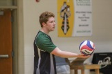 """Junior Cole Gibson concentrates on the volleyball as he holds it out front, ready to serve it over the net. """"Volleyball involves more technique than raw strength or power,"""" said Gibson. Photo by Grace Allen."""