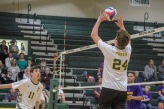 "Junior Ben Purvis sets the ball so sophomore Logan Gamero can spike it over the net. ""I love being on the team because we get hype after every play,"" said Purvis. Photo by Grace Allen."