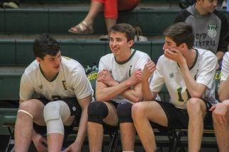 Sophomore Kaleb Quenichet, senior Kaden Breger, and sophomore Logan Gamero chat on the sidelines as their team beats Scottsburg. Photo by Grace Allen.