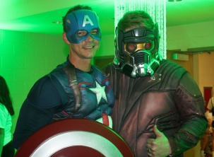 Two after prom volunteers Michael Casper and Mike Whitney dress up in superhero costumes to correlate with the night's theme. Photo by Nicholas Gordon.