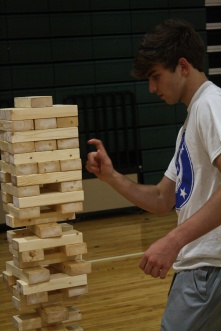 Junior Kyle Rippy plays Jenga which is one of many games that after prom provides. Photo by Nicholas Gordon