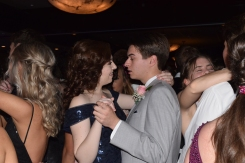 Senior Elizabeth Hallal and her prom date Jordan Burger slow dance. Photo by Kate Zuverink