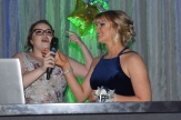Junior Claire Elmore and Natalie Hartman prepare to announce Prom King and Prom Queen. Photo by Kate Zuverink.